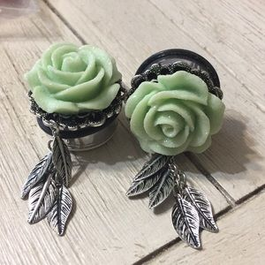 Green flowered plugs body jewelry